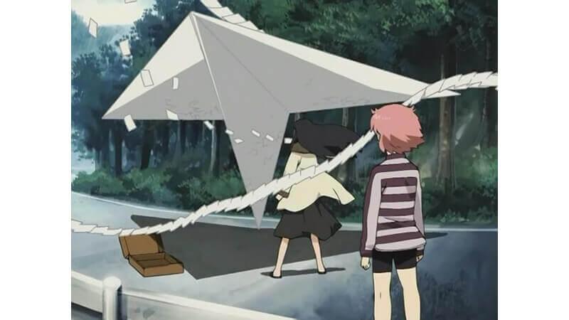 Yomiko making a paper plane