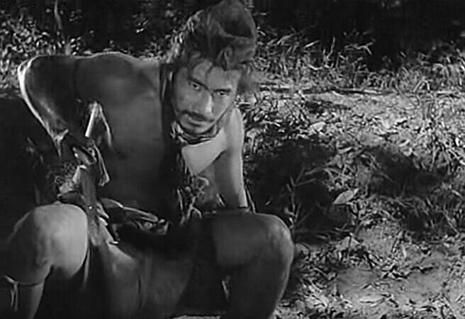 Toshiro Mifune as the cowering Tajomaru