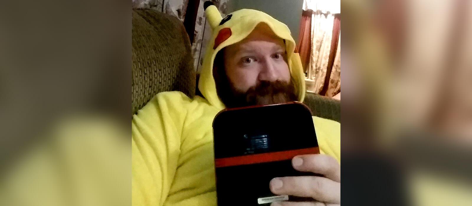 Me in my union suit (Kigurumi) playing Pokemon Moon.