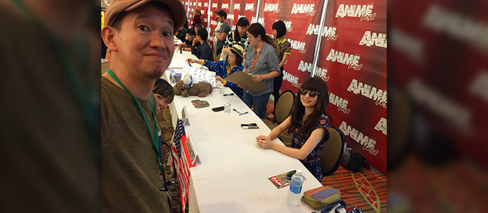 Hiramatsu taking a selfie with Yamamoto and Kubo during AnimeFest