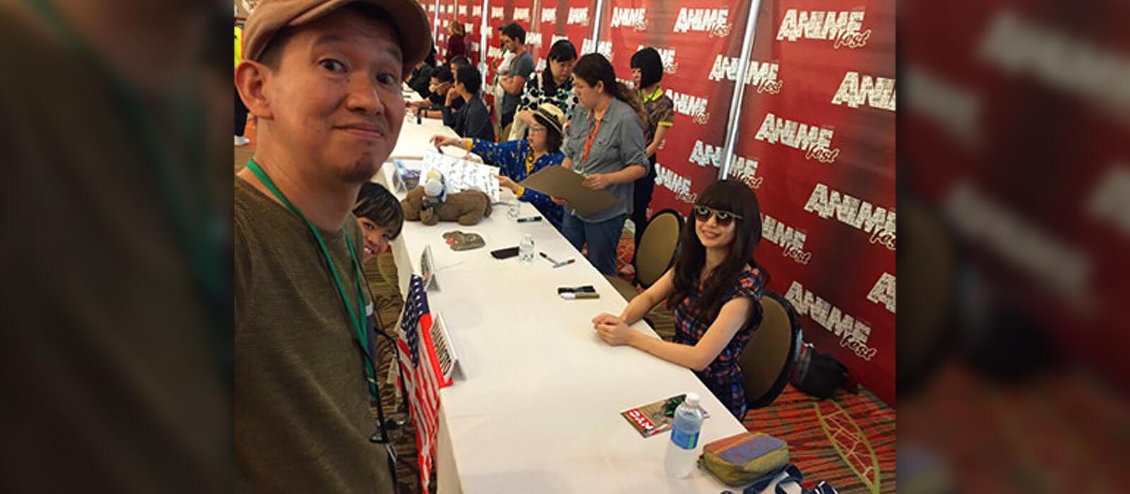 Hiramatsu taking a selfie with Yamamoto and Kubo during AnimeFest