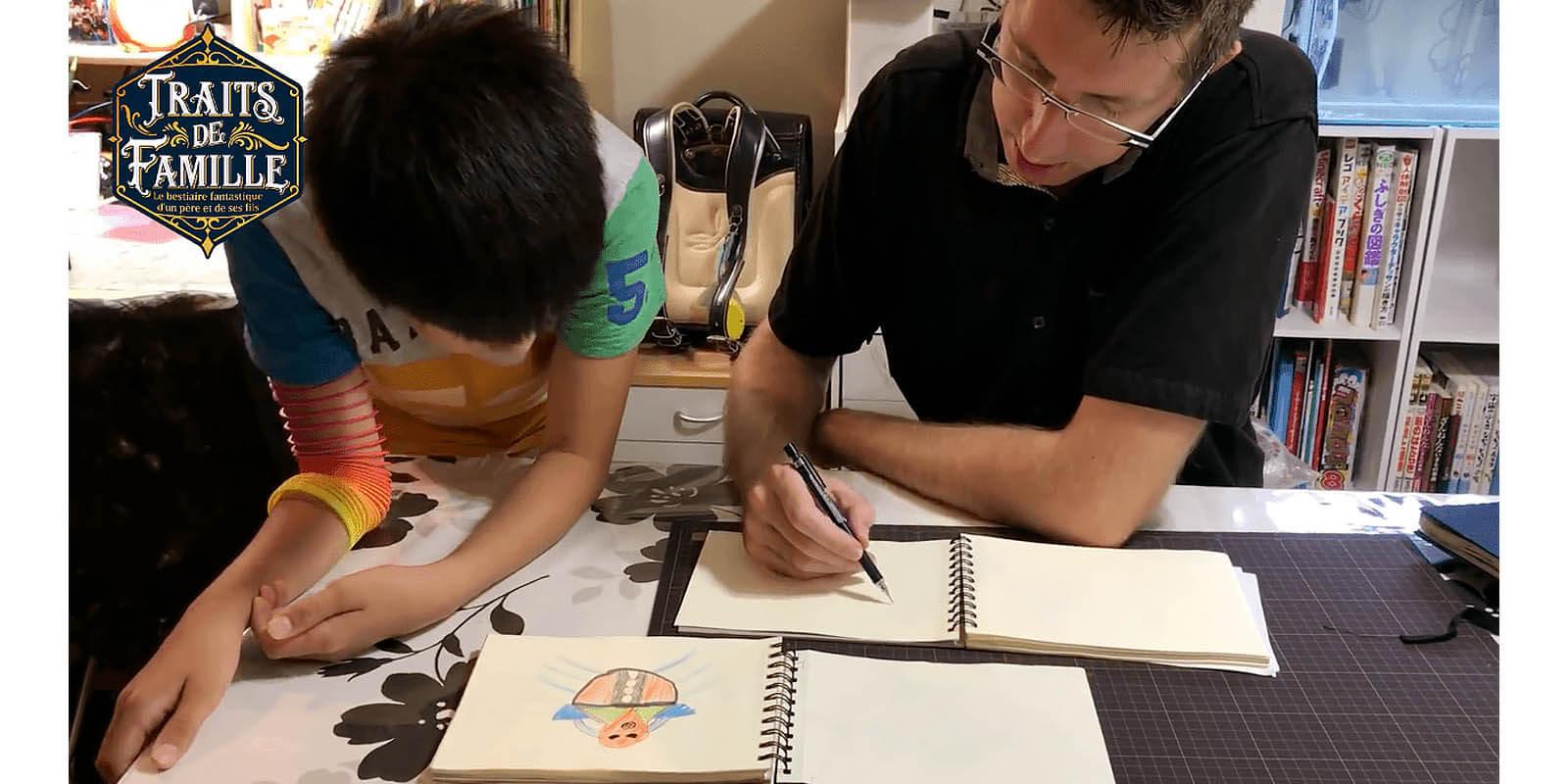 Thomas Romain re-creating his son's drawing.