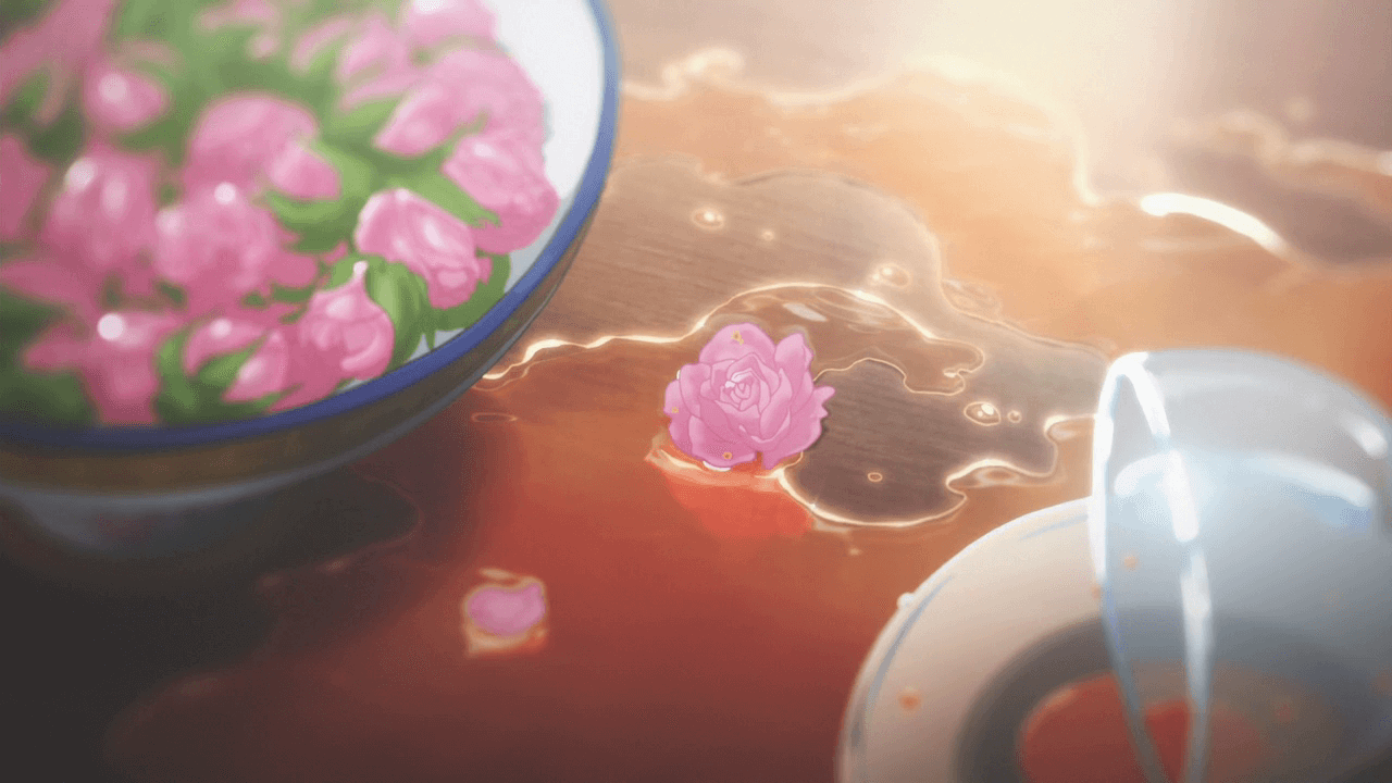 A screenshot of spilled water on a table next to a bowl of flowers