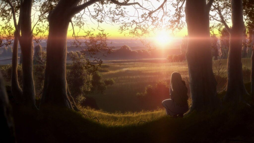 """A screenshot from """"Maquia"""" of a girl kneeling at the edge of a forest as the sun rises in the distance."""