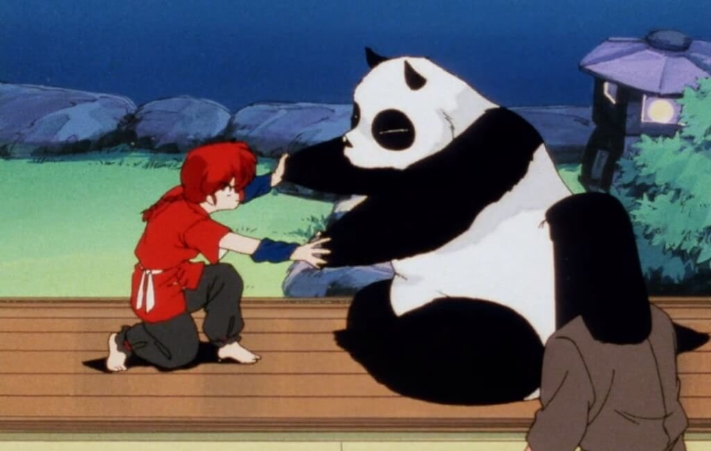 Ranma (as a woman) and Genma (as a panda) get into a physical argument