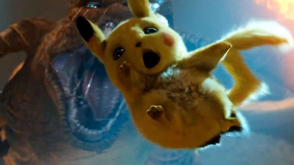 Pikachu falling towards Charizard's mouth