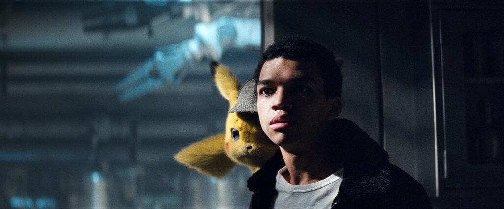 Pikachu sitting on Tim's shoulder
