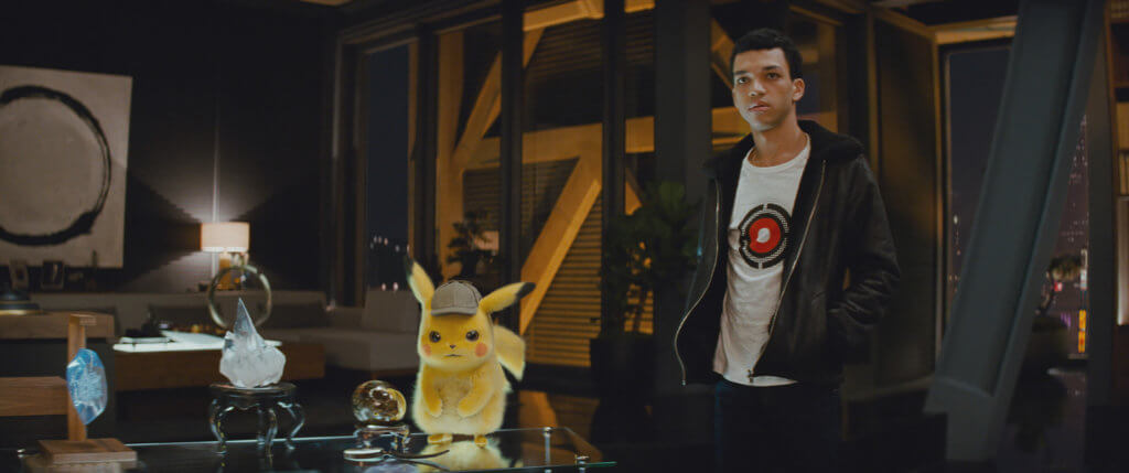 Pikachu looking angry while Tim looks casual