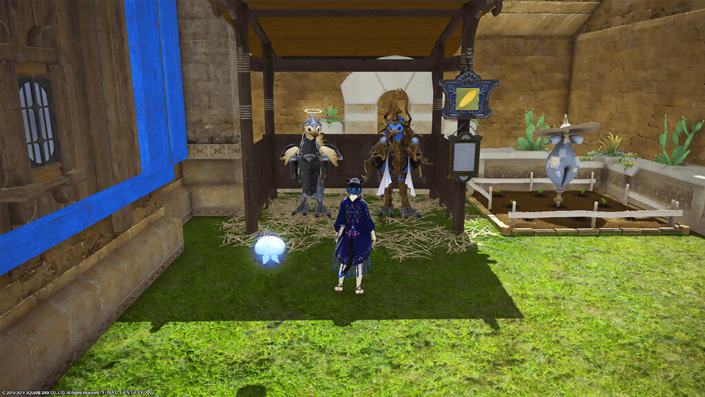 A player with their minion is standing in front of a stable with two chocobos in it.