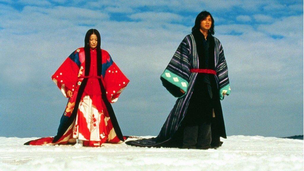 Sawako (Miho Kanno) and Matsumoto (Hidetoshi Nishijima) cross a snowy field
