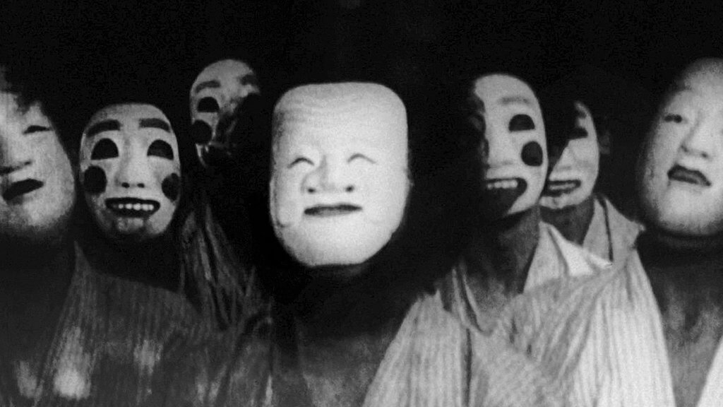 Ghoulish masks haunt an asylum in A Page of Madness