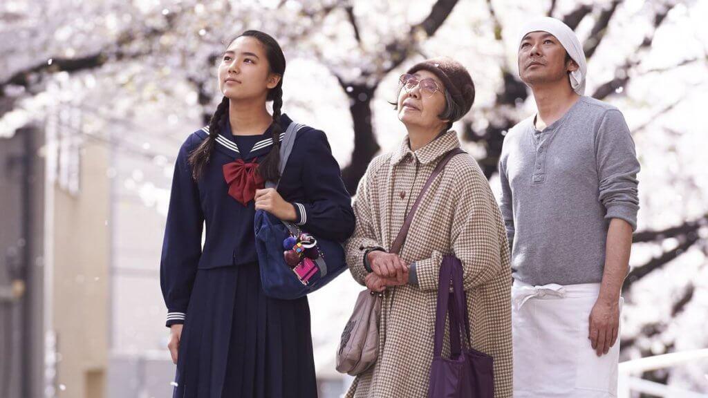 The main characters of Sweet Bean admire the sakura blossoms