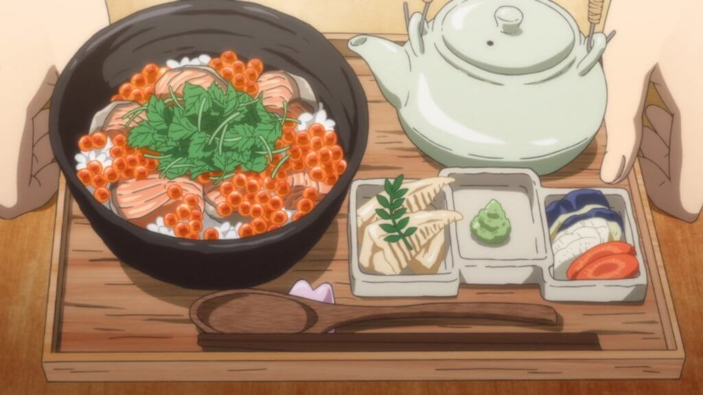 A tray of rice bowl and a pot of tea, with an assortment of side dishes.